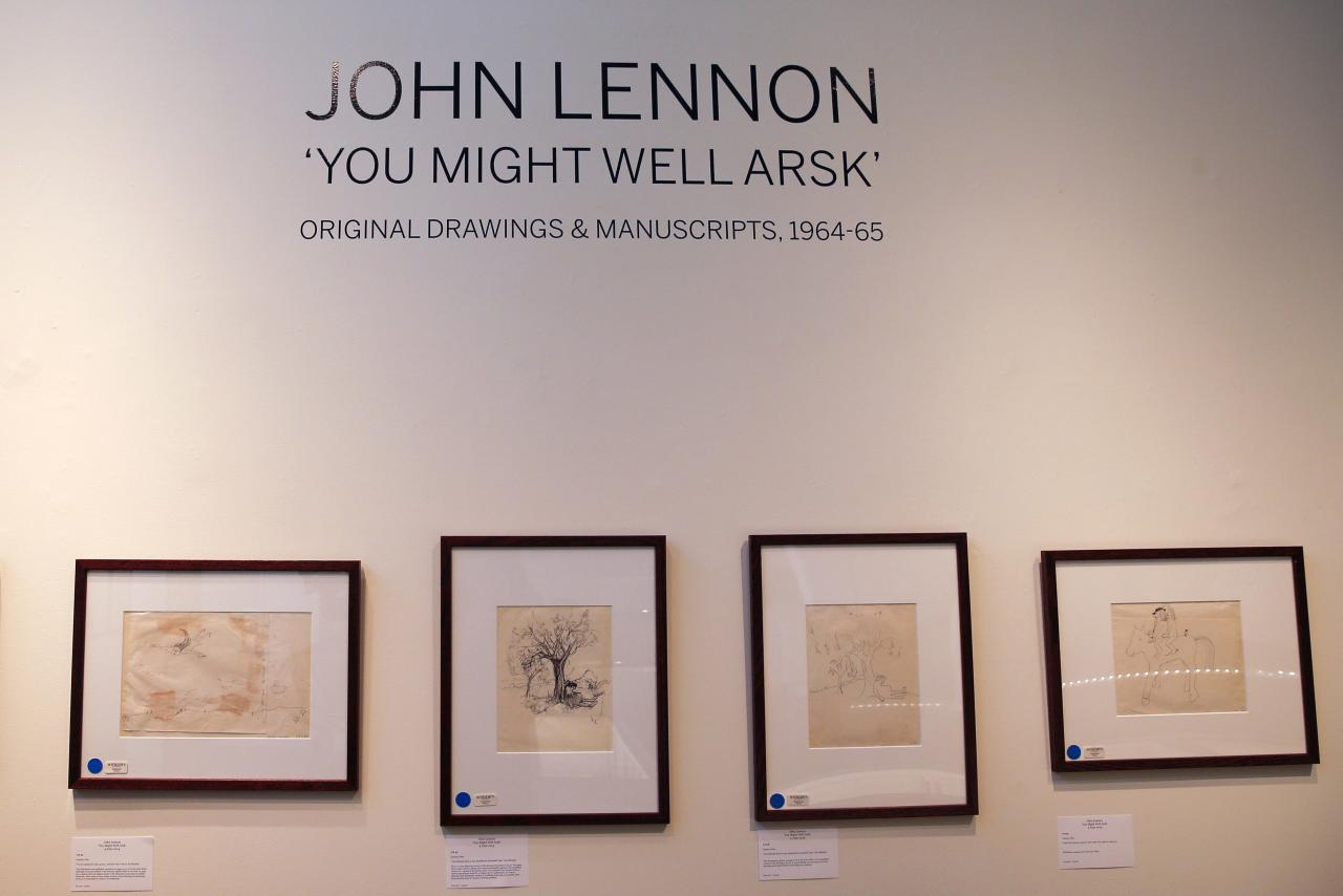 """Drawings are seen as part of John Lennon's original drawings and manuscripts from 1964-65 at Sotheby's auction house in New York May 29, 2014. The drawings and manuscripts were featured in Lennon's books """"In His Own Write"""" and """"A Spaniard in the Works"""" and will be up for auction on June 4. REUTERS/Shannon Stapleton (UNITED STATES - Tags: ENTERTAINMENT)"""