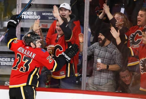 Calgary Sports and Entertainment says it will require all fans, event staff, and employees to be fully vaccinated for attendance at live events at McMahon Stadium and the Saddledome.  (Larry MacDougal/The Canadian Press - image credit)