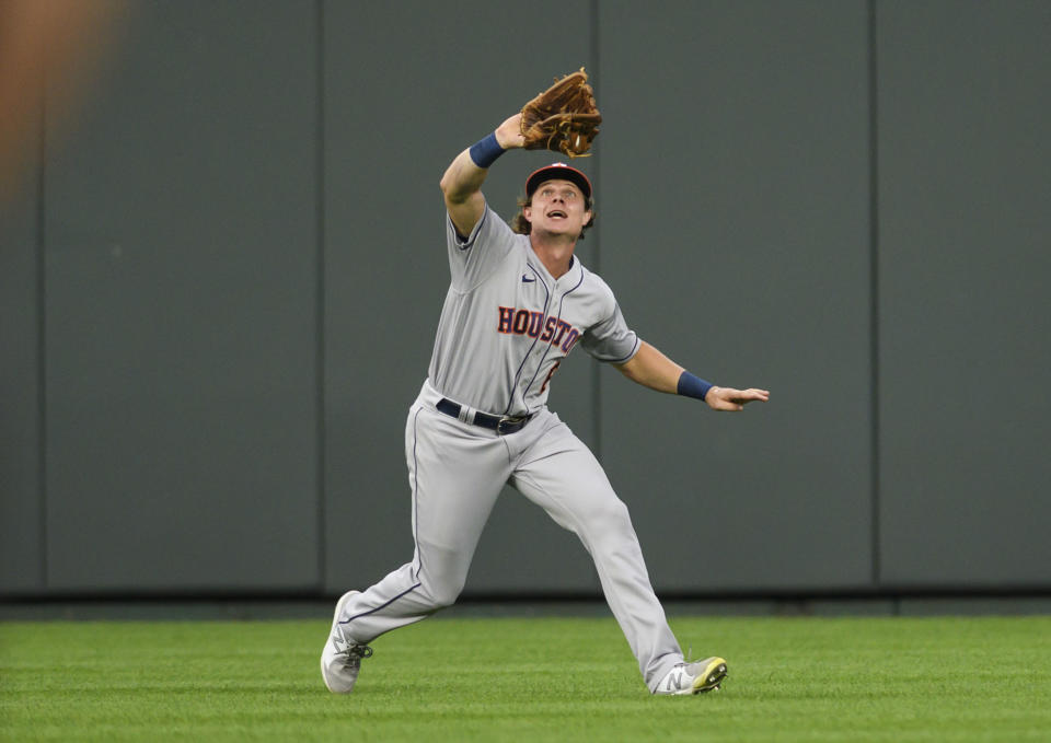Houston Astros center fielder Jake Meyers catches a fly ball hit by Kansas City Royals' Hanser Alberto during the second inning of a baseball game Tuesday, Aug. 17, 2021, in Kansas City, Mo. (AP Photo/Reed Hoffmann)