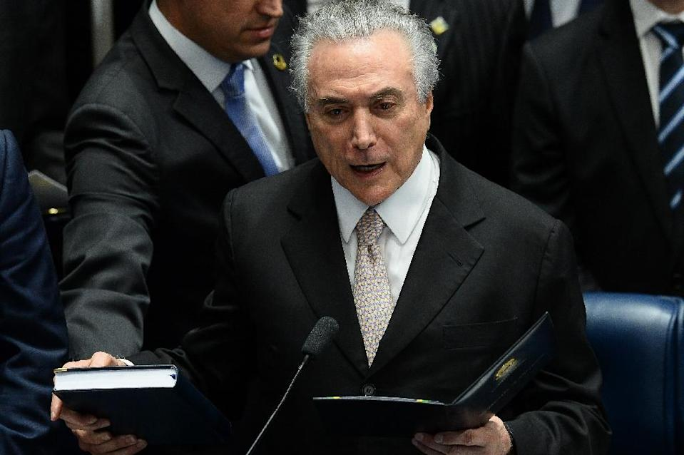 President Michel Temer swears in to take office before the plenary of the Brazilian Senate in Brasilia, on August 31, 2016 (AFP Photo/Andressa Anholete)