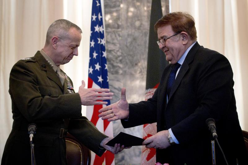 U.S Gen. John Allen, left, commander of NATO and U.S. forces in Afghanistan reaches out to shake hands with Afghan Defense Minister Gen. Abdul Rahim Wardak in Kabul, Afghanistan, Friday, March 9, 2012. Afghan and U.S. military officials have signed a deal to transfer oversight of the main U.S. detention center in the country to the Afghan government within six months.  (AP Photo/Anja Niedringhaus)