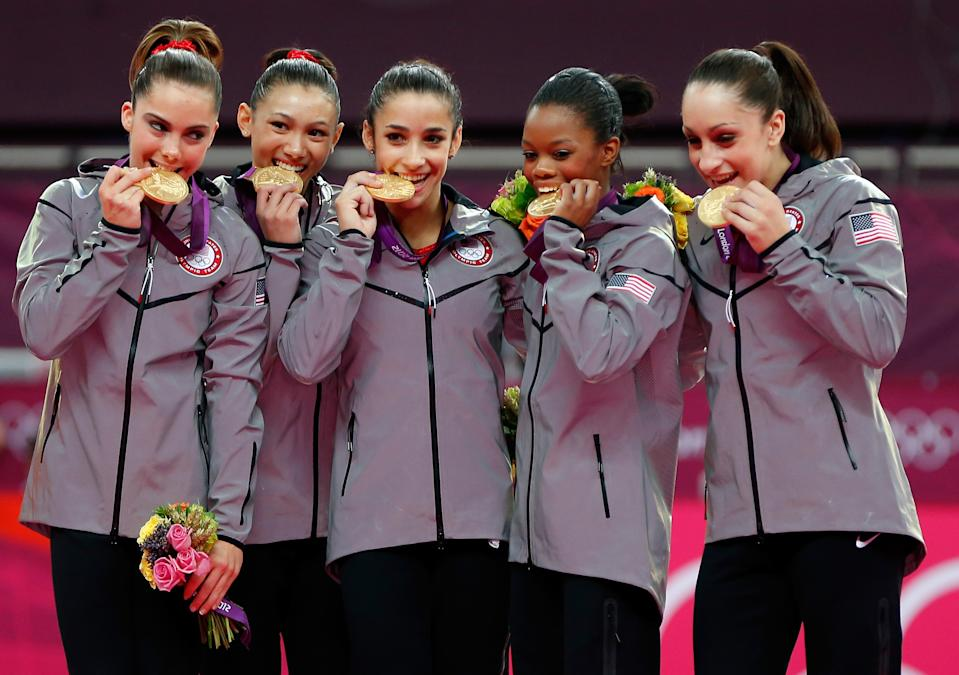"""<a href=""""http://sports.yahoo.com/olympics/gymnastics/mc-kayla-maroney-1134462/"""" data-ylk=""""slk:McKayla Maroney"""" class=""""link rapid-noclick-resp"""">McKayla Maroney</a>, <a href=""""http://sports.yahoo.com/olympics/gymnastics/kyla-ross-1133582/"""" data-ylk=""""slk:Kyla Ross"""" class=""""link rapid-noclick-resp"""">Kyla Ross</a>, <a href=""""http://sports.yahoo.com/olympics/gymnastics/alexandra-raisman-1134192/"""" data-ylk=""""slk:Alexandra Raisman"""" class=""""link rapid-noclick-resp"""">Alexandra Raisman</a>, <a href=""""http://sports.yahoo.com/olympics/gymnastics/gabrielle-douglas-1132742/"""" data-ylk=""""slk:Gabrielle Douglas"""" class=""""link rapid-noclick-resp"""">Gabrielle Douglas</a> and <a href=""""http://sports.yahoo.com/olympics/gymnastics/jordyn-wieber-1131093/"""" data-ylk=""""slk:Jordyn Wieber"""" class=""""link rapid-noclick-resp"""">Jordyn Wieber</a> of the United States celebrate after winning the gold medal in the Artistic Gymnastics Women's Team final on Day 4 of the London 2012 Olympic Games at North Greenwich Arena on July 31, 2012 in London, England. (Photo by Jamie Squire/Getty Images)"""