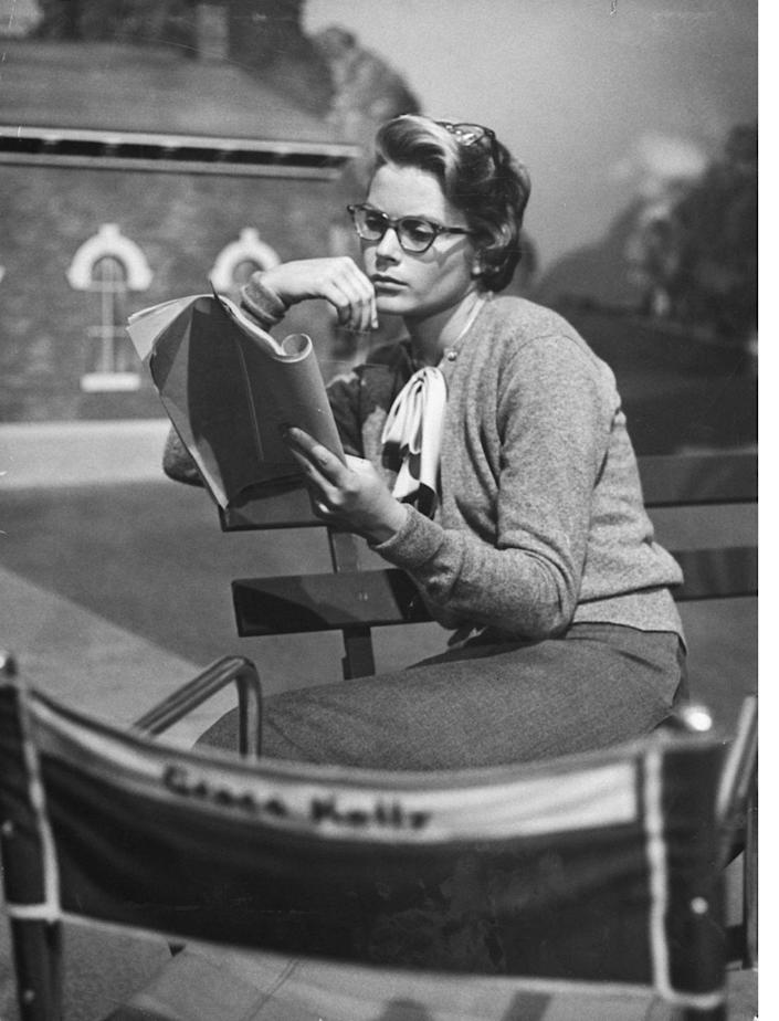 <p>Kelly studies her script on the set of <em>The Country Girl</em>. The actress costarred with Bing Crosby and William Holden in the film as the female lead, Georgie. </p>