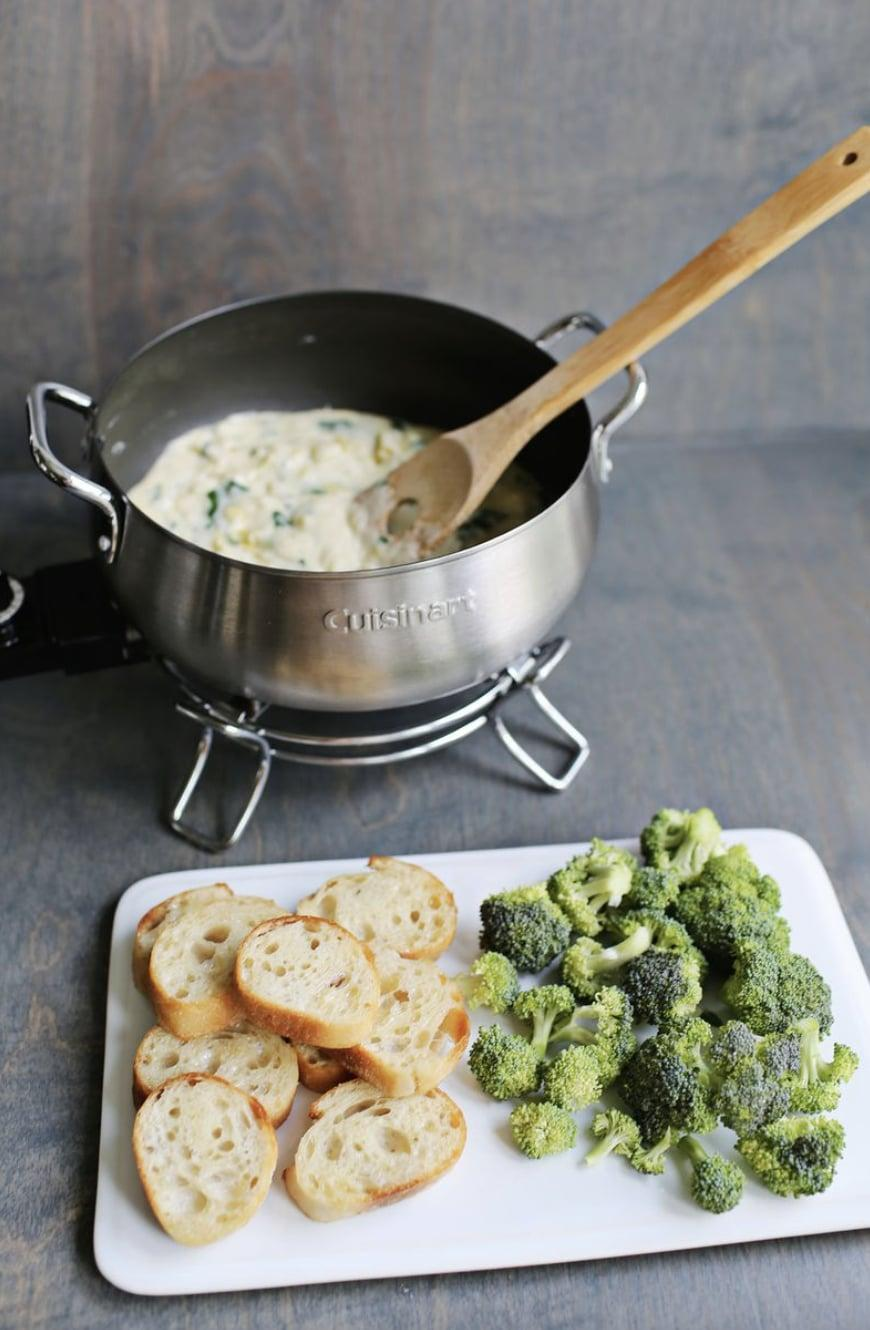 "<p>Imagine: spinach and artichoke dip but better. This fondue recipe is rich, creamy, and oh so flavorful, meaning every time you make it you'll get a ton of compliments in the kitchen. Be sure to grab fresh veggies and warm bread to dip into your new favorite snack.</p> <p><strong>Get the recipe</strong>: <a href=""https://abeautifulmess.com/spinach-and-artichoke-fondue/"" class=""link rapid-noclick-resp"" rel=""nofollow noopener"" target=""_blank"" data-ylk=""slk:spinach and artichoke fondue"">spinach and artichoke fondue</a></p>"