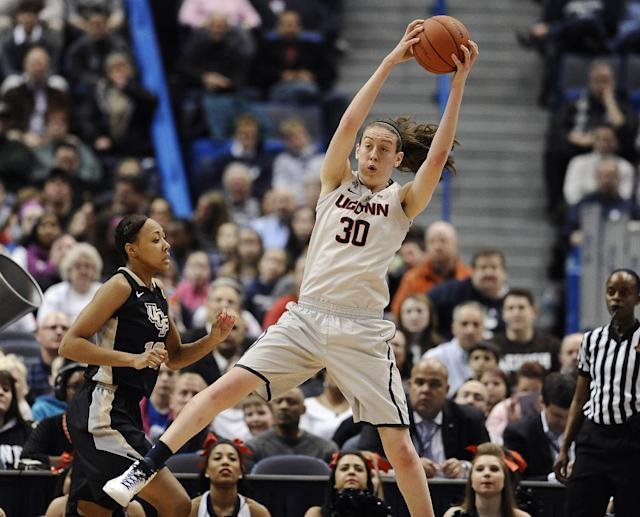 Connecticut's Breanna Stewart reaches up for a defensive rebound as Central Florida's Brittni Montgomery, left, defends during the first half of an NCAA college basketball game, Wednesday, Feb. 19, 2014, in Hartford, Conn. (AP Photo/Jessica Hill)