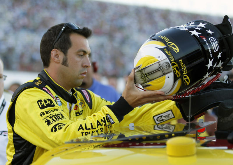 Sam Hornish Jr. prepares to get in AJ Allmendinger's car as a replacement driver in the NASCAR Sprint Cup Series auto race at Daytona International Speedway, Saturday, July 7, 2012, in Daytona Beach, Fla. Allmendinger was temporarily suspended after failing a random drug test. (AP Photo/Terry Renna)