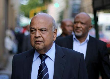 South Africa's Finance Minister Pravin Gordhan walks with his deputy, Mcebisi Jonas as they walk from their offices to a court hearing in Pretoria