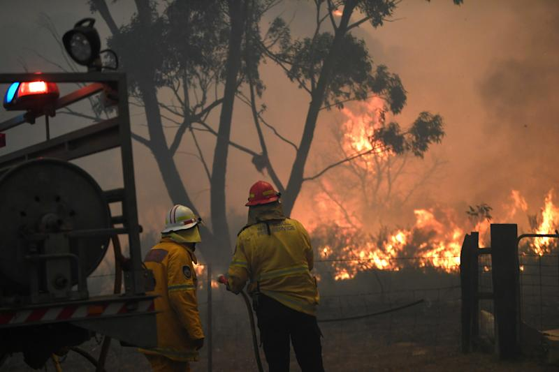 NSW firefighters are seen trying to protect homes near Tahmoor.