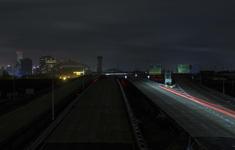 A lone car heads west on the Pontchartrain Expressway Monday, Aug. 30, 2021 after New Orleans lost power during Hurricane Ida. (David Grunfeld/The Advocate via AP)