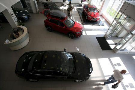 Mazda 6 and CX 5 models are on sale at a showroom of the Avtomir company, a Mazda cars dealership, in Moscow, Russia August 12, 2015. REUTERS/Maxim Zmeyev