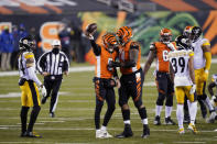 Cincinnati Bengals quarterback Ryan Finley (5) reacts with offensive guard Fred Johnson (74) after Finley rushed for a first down during the second half of an NFL football game against the Pittsburgh Steelers, Monday, Dec. 21, 2020, in Cincinnati. (AP Photo/Bryan Woolston)