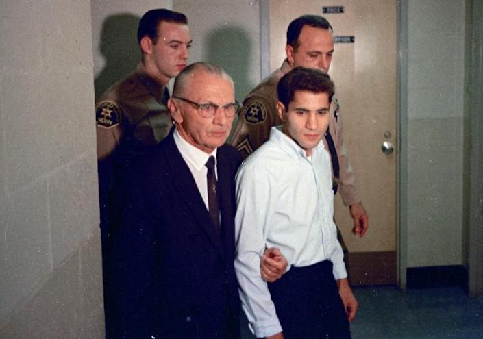 FILE - This June 1968 file photo shows Sirhan Sirhan, right, a suspect of shooting Sen. Robert F. Kennedy, with his attorney Russell E. Parsons in Los Angeles. Associated Press Hollywood reporter Bob Thomas was on a one-night political assignment in June 1968 to cover Kennedy's victory in the California presidential primary when mayhem unfolded before his eyes. (AP Photo/File)