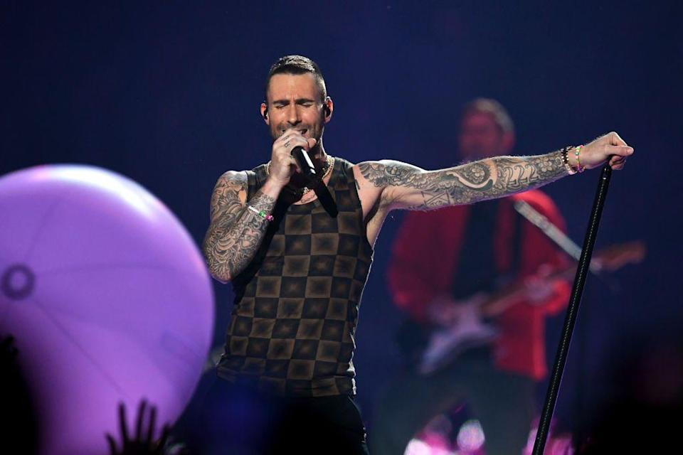 <p>As the performance went on Levine undressed, revealing a printed vest.</p>