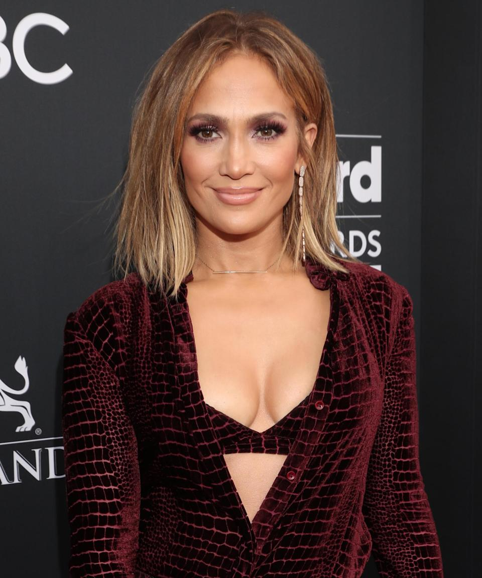 """<h3>2018</h3><br>For the 2018 Billboard Music Awards, Lopez wore her honey-blonde hair in a wispy bob, which was a far cry from her favorite super-long extensions.<span class=""""copyright"""">Photo: Todd Williamson/NBC/NBCU Photo Bank/Getty Images.</span>"""