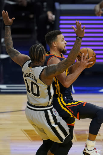 Golden State Warriors guard Stephen Curry, right, drives against San Antonio Spurs forward DeMar DeRozan (10) during the first half of an NBA basketball game in San Francisco, Wednesday, Jan. 20, 2021. (AP Photo/Jeff Chiu)