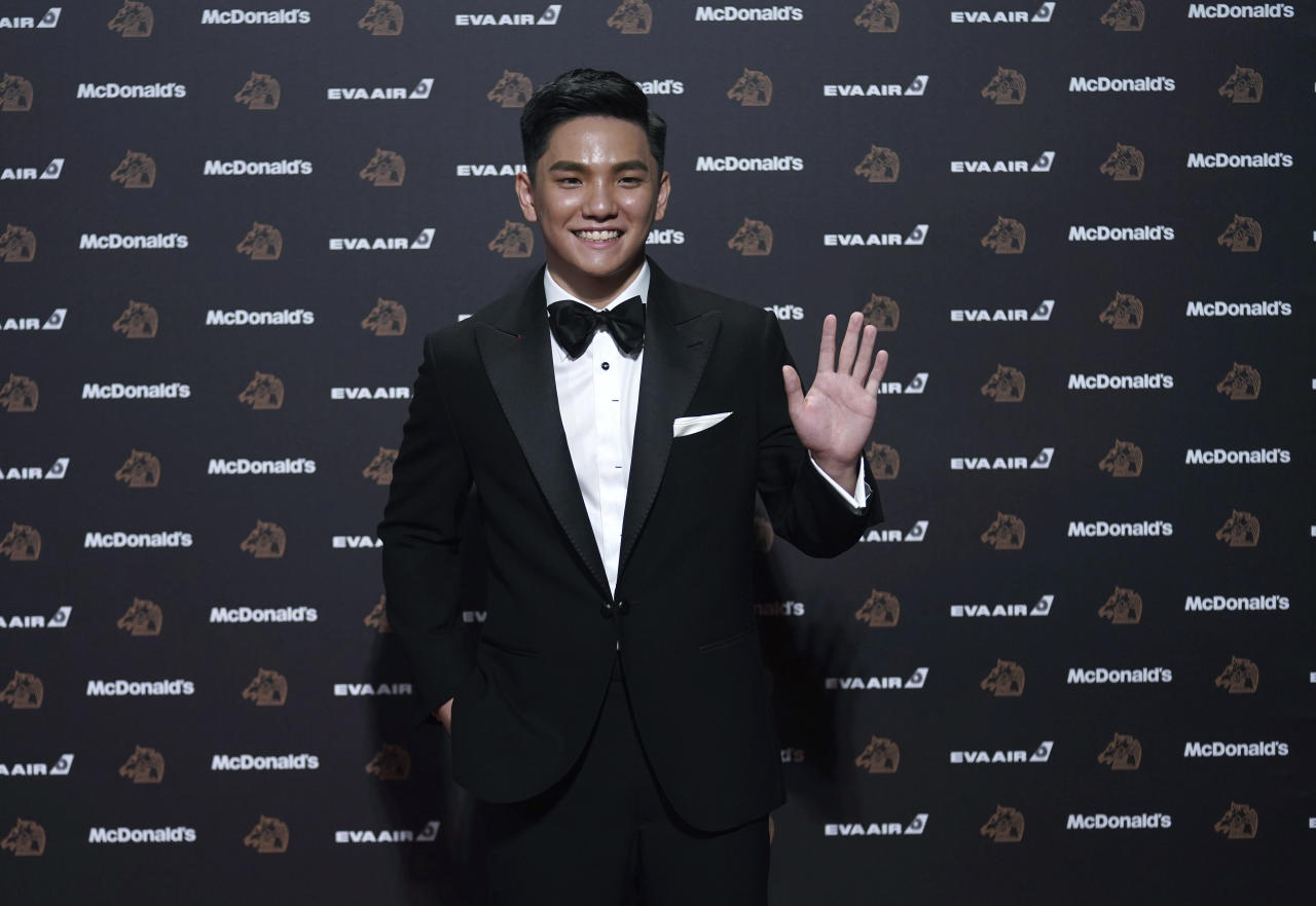 "Singapore actor Koh Jia-ler arrives at the 56th Golden Horse Awards in Taipei, Taiwan, Saturday, Nov. 23, 2019. Koh is nominated for Best Supporting Actor for the film ""Wet Season"" at this year's Golden Horse Awards -one of the Chinese-language film industry's biggest annual events. (AP Photo/ Billy Dai)"