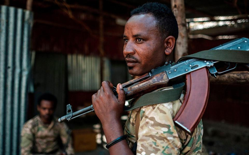 A member of the Amhara Special Forces looks on as he holds his rifle at the 5th Battalion of the Northern Command of the Ethiopian Army in Dansha, Ethiopia - AFP