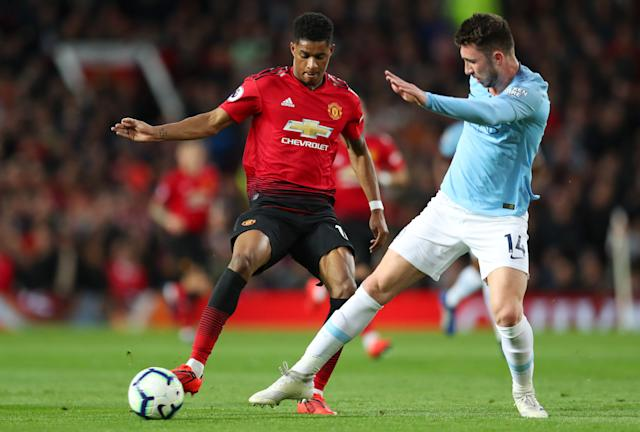 Marcus Rashford of Manchester United battles for possession with Aymeric Laporte of Manchester City during the Premier League match between Manchester United and Manchester City.