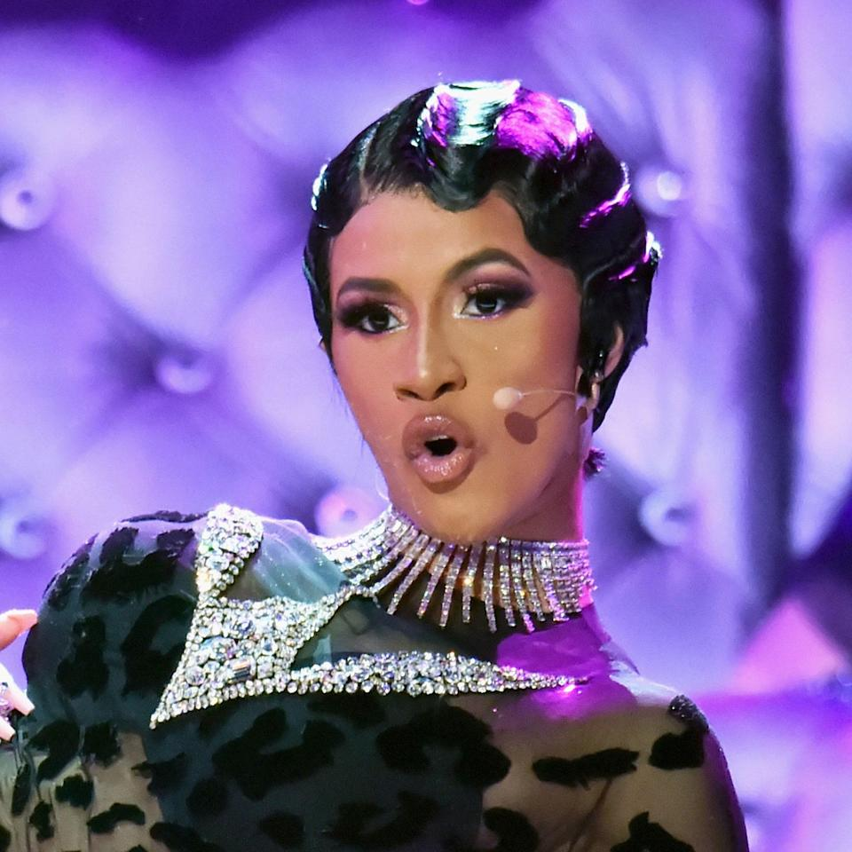 """When she stepped on the 2019 Grammy Awards red carpet, Cardi wowed spectators in a vintage 1995 Mugler Couture piece and a <a href=""""https://www.allure.com/story/cardi-b-grammy-awards-2019-hair-makeup?mbid=synd_yahoo_rss"""" rel=""""nofollow noopener"""" target=""""_blank"""" data-ylk=""""slk:slicked-back updo"""" class=""""link rapid-noclick-resp"""">slicked-back updo</a> wrapped in pearls. Later that night, the artist showed up on stage to <a href=""""https://www.youtube.com/watch?v=4G-ULhfBLjM"""" rel=""""nofollow noopener"""" target=""""_blank"""" data-ylk=""""slk:perform her 2018 hit"""" class=""""link rapid-noclick-resp"""">perform her 2018 hit</a> """"Money"""" with a look equally as timeless: gorgeous jet-black finger waves."""