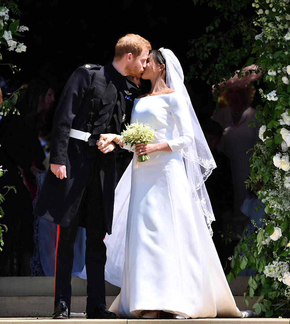 <p>Meghan Markle wed Prince Harry in a history-making ceremony on May 19 at St George's Chapel in Windsor. Over 11.5 million royal fans are believed to have tuned in on the big day to watch the former actress grace the aisle in a Givenchy gown – which reportedly cost over £200,000. To accessorise her bridal look, Meghan borrowed Queen Mary's Filigree tiara from the royal vaults and undoubtedly stole the spotlight thanks to a five-metre sheer veil. <em>[Photo: Getty]</em> </p>