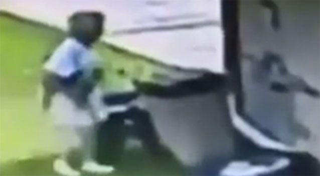 A woman has been caught on camera putting her neighbour's dog into a bin. Source: KHOU 11 News