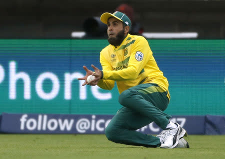 Britain Cricket - Pakistan v South Africa - 2017 ICC Champions Trophy Group B - Edgbaston - June 7, 2017 South Africa's Imran Tahir catches out Pakistan's Mohammad Hafeez Action Images via Reuters / Andrew Boyers Livepic