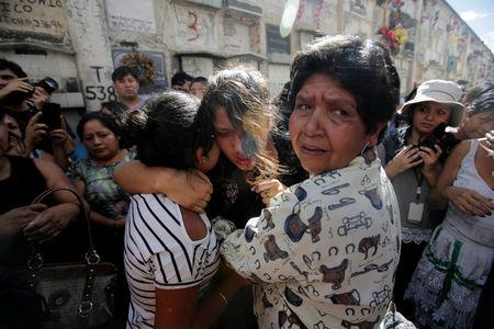 Friends and Family attend the funeral of Madelin Patricia Hernandez, a victim of a fire at the Virgen de Asuncion children shelter, at the cemetery in Guatemala City,