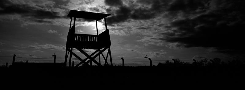 An observation tower stands inside the former Nazi death camp of Auschwitz Birkenau or Auschwitz II in Oswiecim, Poland, Sunday, Dec. 8, 2019. On Jan. 27, 1945, the Soviet Red Army liberated the Auschwitz death camp in German-occupied Poland. Auschwitz was the largest of the Germans' extermination and death camps and has become a symbol for the terror of the Holocaust. In advance of that, Associated Press photographer Markus Schreiber visited the site. Using a panoramic camera with analog film, he documented the remains of the camp in a series of haunting black and white photos. (AP Photo/Markus Schreiber)