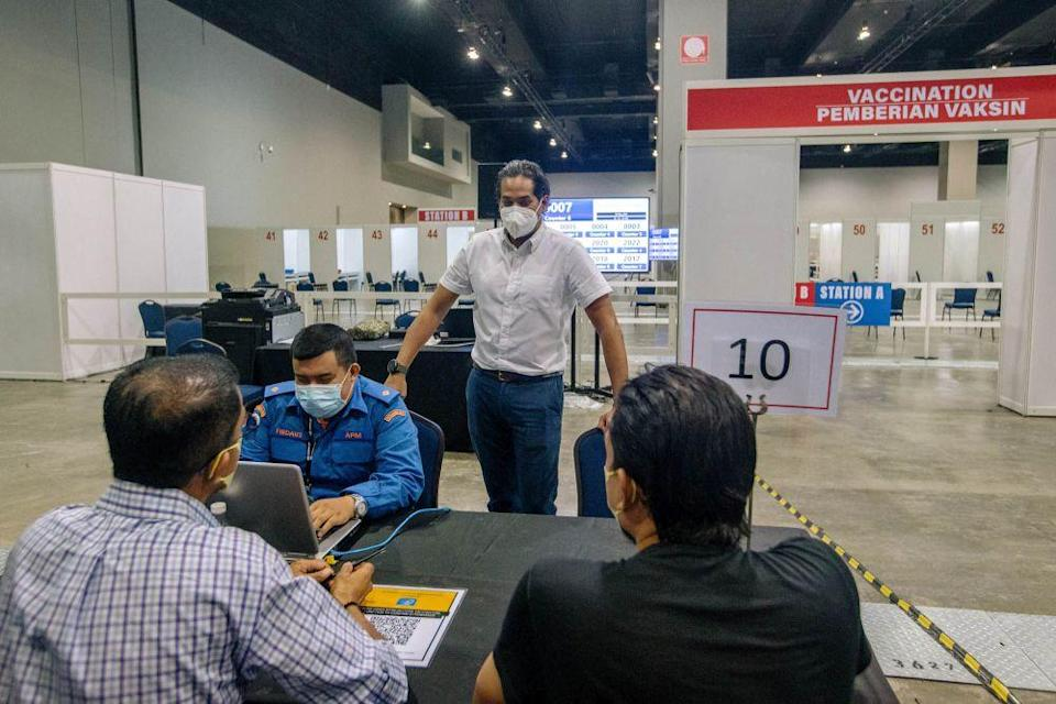 Minister of Science, Technology and Innovation Khairy Jamaluddin during a visit to vaccination centre at  the Malaysia International Trade and Exhibition Centre in Kuala Lumpur May 30, 2021. —  Picture by Firdaus Latif