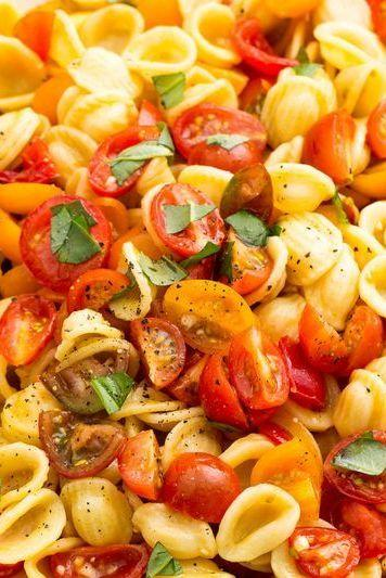"""<p>This salad is the epitome of summer in a bowl.</p><p>Get the <a href=""""https://www.delish.com/uk/cooking/recipes/a32399230/bruschetta-pasta-salad-recipe/"""" target=""""_blank"""">Bruschetta Salad</a> recipe.</p>"""