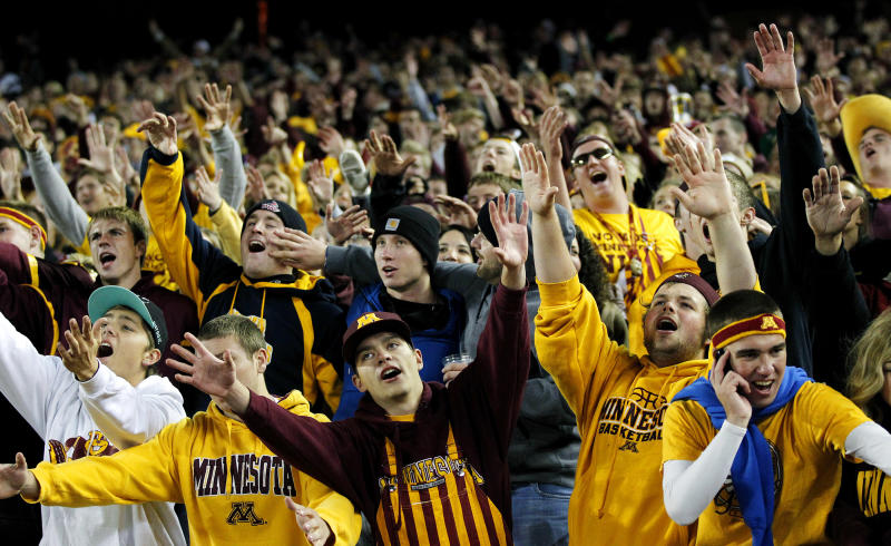 Minnesota student fans cheer during the second half of an NCAA college football game against Syracuse in Minneapolis, Saturday Sept. 22, 2012. Minnesota defeated Syracuse 17-10. (AP Photo/Andy King)