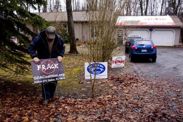 Craig Sautners places an anti-fracking sign outside his house in Dimock, Pennsylvania January 11, 2012.