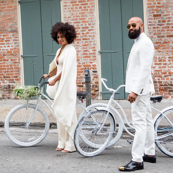 <p>Their wedding gave them the title of 'Coolest Couple Ever'. Their nuptials hipster details just kept on coming, including the couple arriving on white bikes - too cool. <i>[Photo: Josh Brasted/WireImage]</i></p>