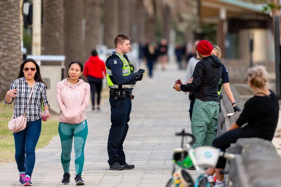All over Melbourne, police are out in high numbers questioning people to ensure they are not breaking the strict social distancing rules. Source: Getty