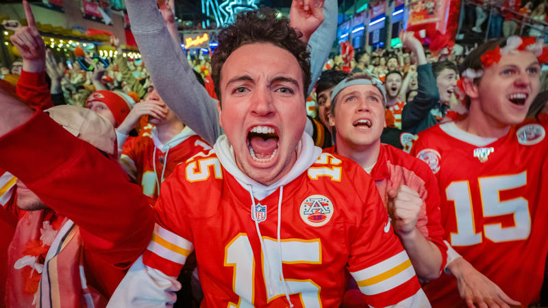 A Chiefs fan, pictured here screaming in excitement during the Super Bowl.