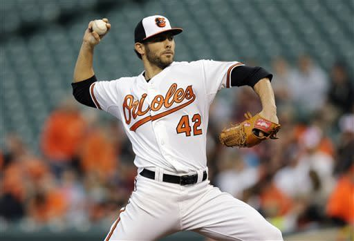 Baltimore Orioles starting pitcher Jake Arrieta throws to the Tampa Bay Rays in the first inning of a baseball game on Tuesday, April 16, 2013, in Baltimore. (AP Photo/Patrick Semansky)