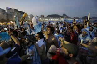 Argentina fans gather on Copacabana Beach on Saturday. (AP Photo)