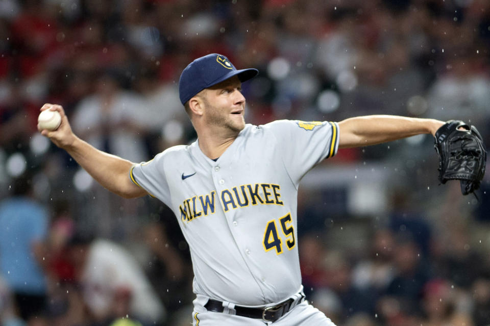 Milwaukee Brewers relief pitcher Brad Boxberger throws against the Atlanta Braves during the sixth inning of a baseball game Friday, July 30, 2021, in Atlanta. (AP Photo/Hakim Wright Sr.)