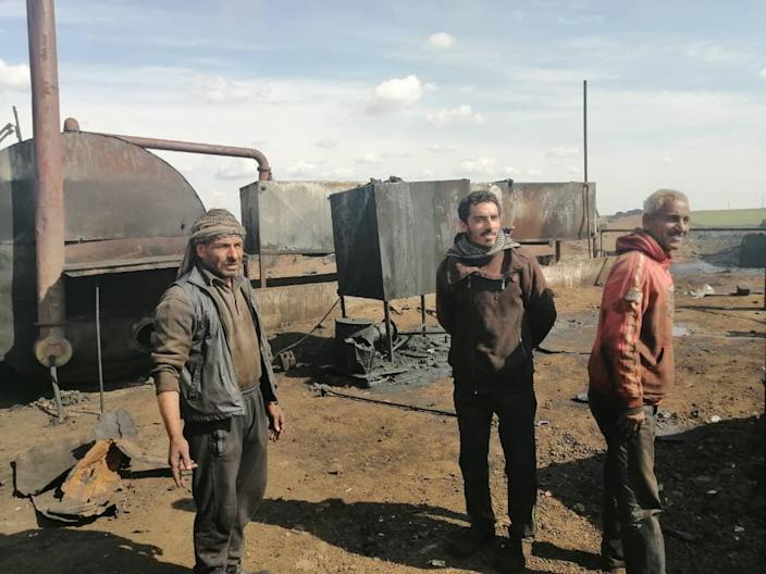 """<div class=""""inline-image__caption""""><p>Maher Joumaa Howair, Ahmad Abu Mohamad, and an unidentified oil refinery worker. </p></div> <div class=""""inline-image__credit"""">Kenneth R. Rosen</div>"""