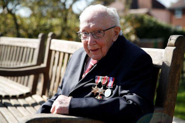 PHOTO: Retired British Army Captain Tom Moore, 99, poses as he continued to raise money for health workers, by attempting to walk the length of his garden one hundred times before his 100th birthday this month, Marston Moretaine, Britain, April 15, 2020. (Peter Cziborra/Reuters, FILE)