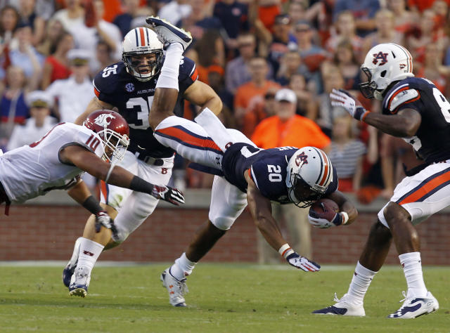 Auburn Tigers running back Corey Grant (20) dives for extra yardage after being tripped up by Washington State linebacker Justin Sagote (10) during the first half of an NCAA college football game against Washington State on Saturday, Aug. 31, 2013, in Auburn, Ala. (AP Photo/Butch Dill)