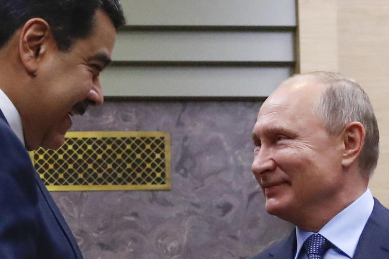 FILE - In this Dec. 5, 2018 file photo, Venezuelan President Nicolas Maduro, left, and Russian President Vladimir Putin greet each other outside the Novo-Ogaryovo residence in Moscow, Russia. Russia is an ally of the Venezuelan president, who is under challenge from opposition leader Juan Guaido in a resurgence of the country's political crisis after declaring presidential authority and vowing to oust the socialist leader. (Maxim Shemetov/Pool Photo via AP File)