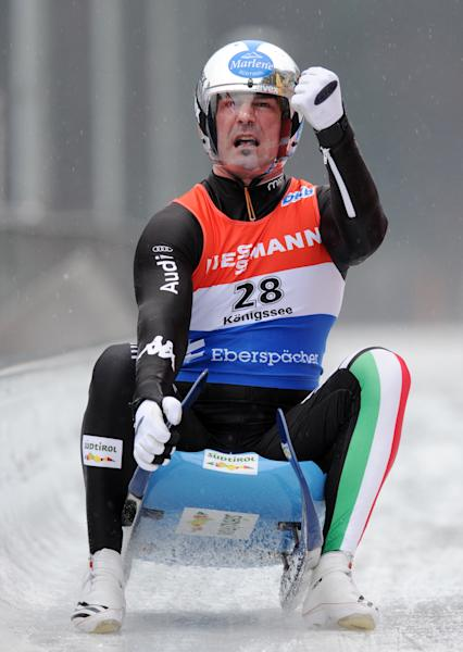 Armin Zoggeler from Italy celebrates after finishing second at the men's Luge World Cup in Koenigssee, Germany, Sunday, Jan. 5, 2014. (AP Photo/dpa,Tobias Hase)
