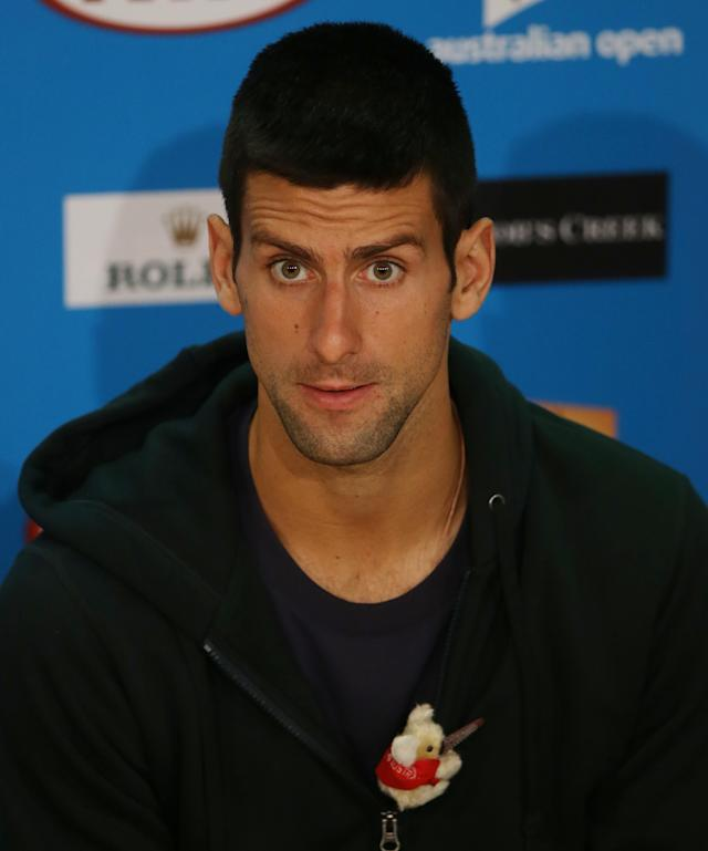 Serbia's Novak Djokovic answers questions at a press conference ahead of the men's final at the Australian Open tennis championship in Melbourne, Australia, Saturday, Jan. 26, 2013. Djokovic will play Britain's Andy Murray in the men's singles final here Sunday Jan. 27. (AP Photo/Dita Alangkara)