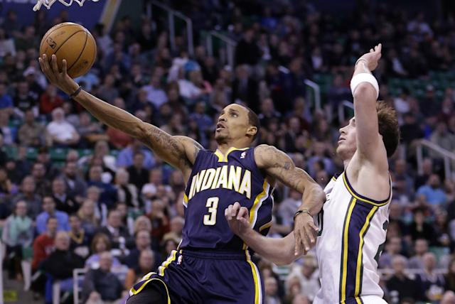 Indiana Pacers' George Hill (3) lays the ball up as Utah Jazz's Gordon Hayward (20) looks on in the second quarter during an NBA basketball game Wednesday, Dec. 4, 2013, in Salt Lake City. (AP Photo/Rick Bowmer)