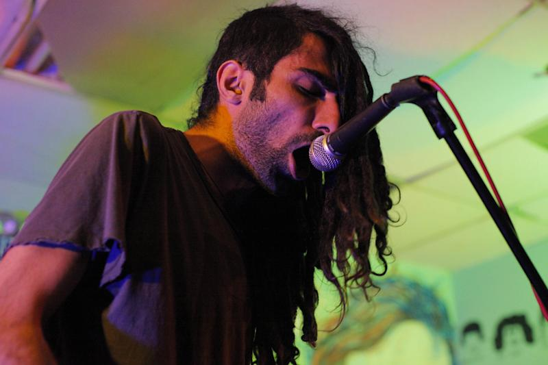 This 2012 photo shows Yellow Dogs band member, singer Siavash Karampour, at the Death By Audio performance space in the Brooklyn borough of New York. Police say a musician who shot and killed three other Iranian men inside a New York City apartment before committing suicide was upset because he had been kicked out of an indie rock band. Ali Akbar Mohammadi Rafie gunned down the men just after midnight on Monday, Nov. 11, 2013. Victims Soroush and Arash Farazmand were brothers who played in a band called the Yellow Dogs. The third victim, Ali Eskandarian was also a musician. After the shooting, investigators found a guitar case on a rooftop they believe the shooter may have used to carry the assault rifle used in the attack.(AP Photo/Danny Krug) NO SALES