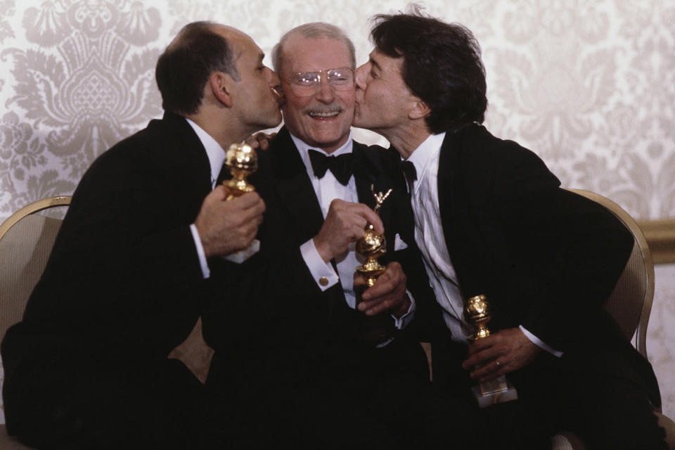 <p>Laurence Olivier (center) won the Cecil B. DeMille Award in 1983.</p>