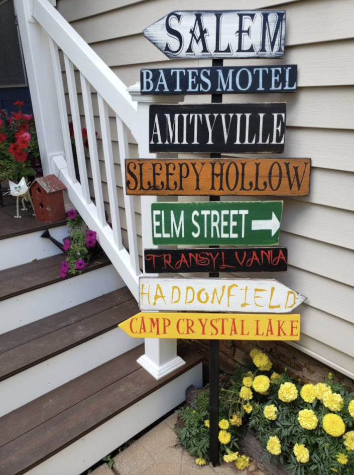 Halloween Porch Sign with salem, bates model, amityville, sleepy hollow, elm street, and more