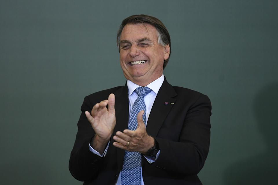 BRASILIA, BRAZIL - OCTOBER 07: President of Brazil, Jair Bolsonaro, accompanying the Minister of Health of Brazil, Marcelo Queiroga, ceremony for the Modernization of Occupational Health and Safety Regulation, at Planalto Palace in Brasilia, Brazil October 7, 2021. (Photo by Mateus Bonomi/Anadolu Agency via Getty Images)