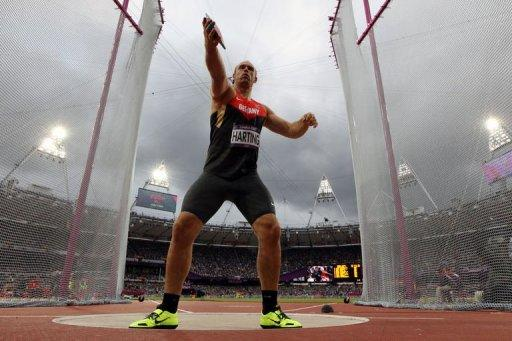 Germany's Robert Harting competes to win the men's discus throw final